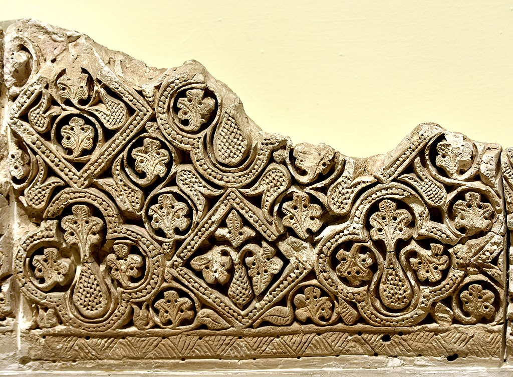 1024px-Carved_stucco_panel_from_Samarra,_3rd_century_AH._1st_style._Iraq_Museum.jpg