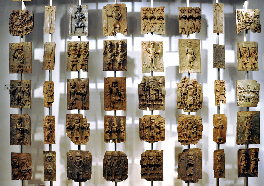 1024px-Cast_brass_plaques_from_Benin_City_at_British_Museum.jpg