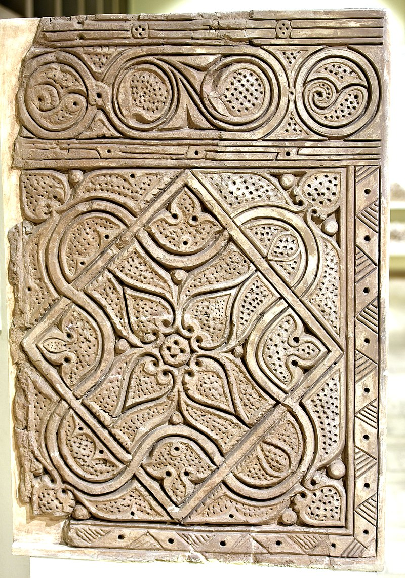 800px-Carved_stucco_panel_from_Samarra,_Iraq,_3rd_century_A.H.,_Iraq_Museum.jpg
