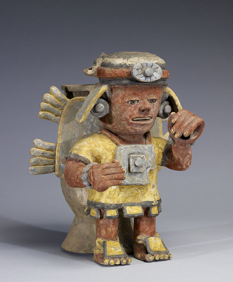 800px-Mixtec_-_Polychrome_Standing_Figure_with_Raised_Hand_-_Walters_482812_-_Three_Quarter.jpg