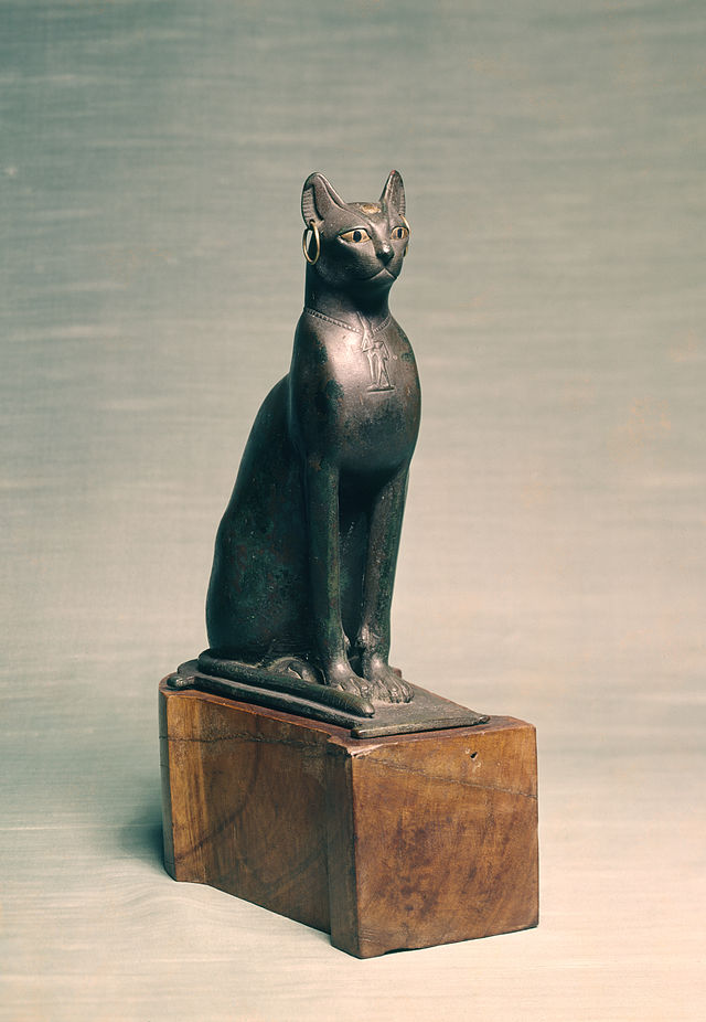Egyptian_-_Statue_of_a_Seated_Cat_-_Walters_54403_-_Three_Quarter.jpg