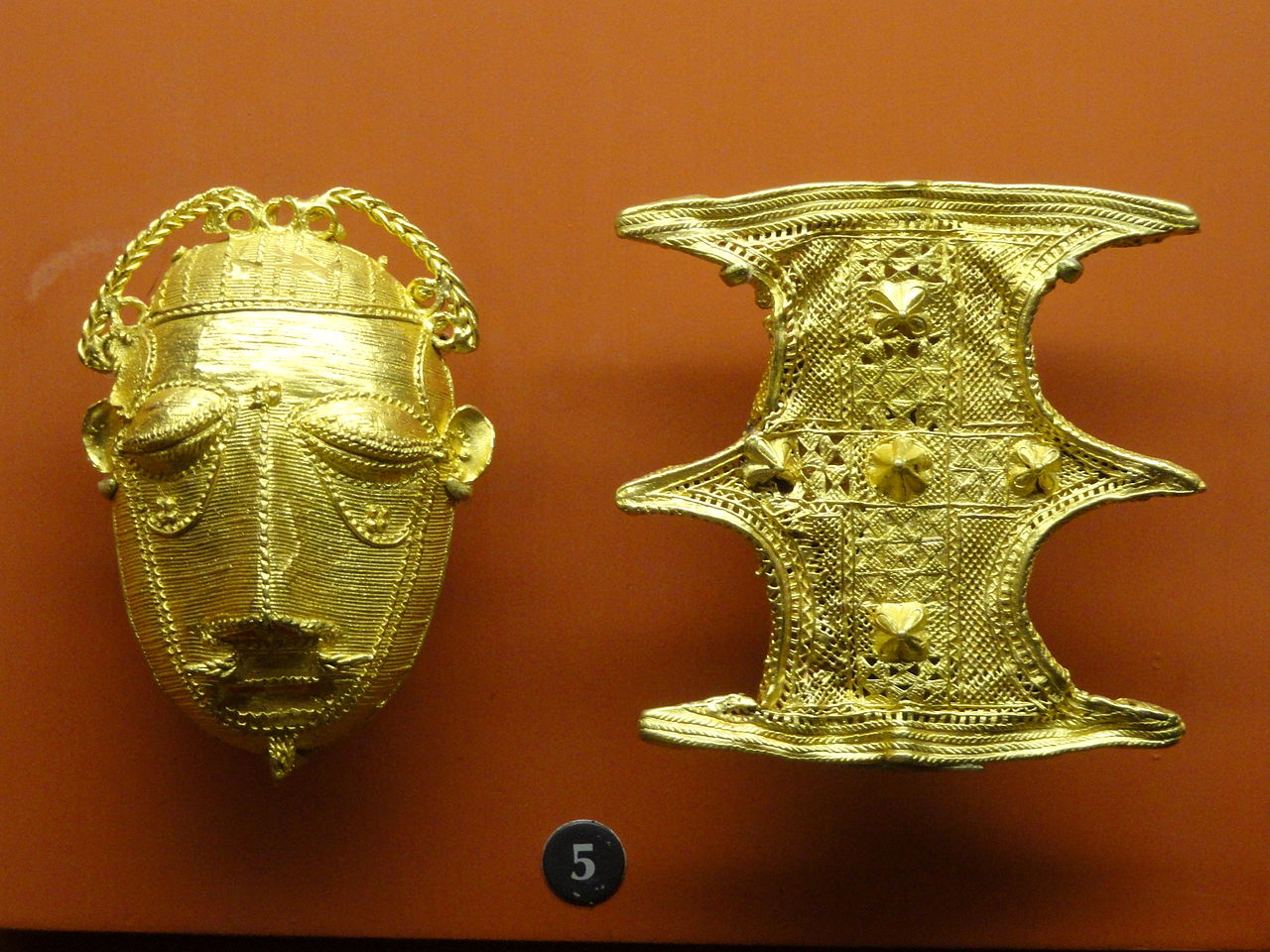 Gold_ornaments_(mask_and_shield),_Ashanti_-_.JPG