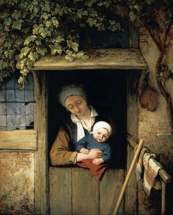 mother-holding-her-child-in-a-doorway.jpg