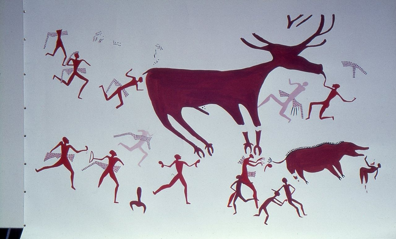Restored_copy_of_Çatalhöyük_mural_showing_a_boar_and_a_deer_surrounded_by_hunters..jpg