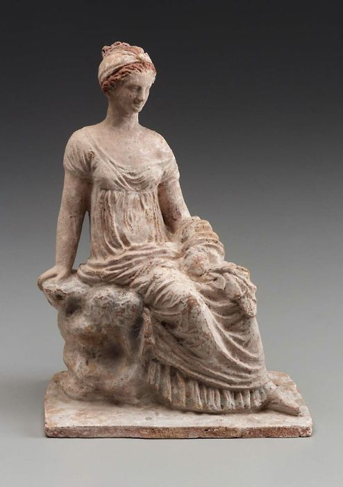 terracotta-woman-seated-on-a-rock-made-in-tanagra-greece-3rd-century-bc-1347431355_b.jpg